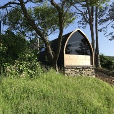 Our 'eco' wood burning sauna pod - glass end with sea view, seats up to 15!