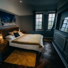 Callum's Room - king-sized oak bed and a view of Barmouth from the windows