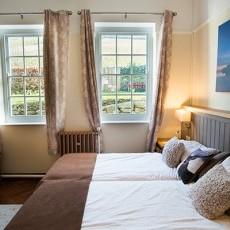 The Silver Room is an accessible ground floor bedroom with accessible en-suite - twin beds can be pulled together to make Super King