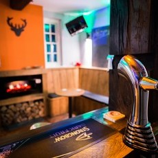 Ty Gwyn has its very own bar with stools and benches, feature fire, oak bar, fridge and optics.