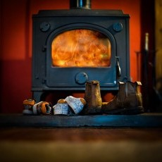 The amazing cast iron wood burner in the lounge - we even supply the logs for this!